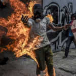 Watch military tank attack Venezuelan protesters